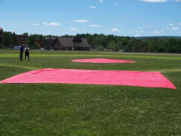 Kaplan Tarps manufactures field covers for local schools.
