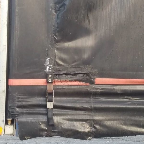 Tarp repair work by Kaplan tarps & cargo controls