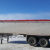 Red side roll tarp sold by Kaplan Tarps & Cargo Controls